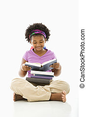 Girl reading books. - African American girl with large stack...