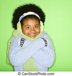 Winter girl. - African American girl in winter clothing with...