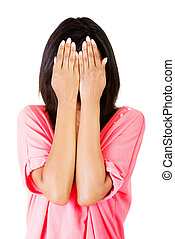 Young teen woman covering her face with hands