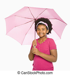 Girl with parasol - African American girl holding pink...