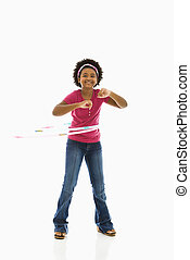 Girl with hula hoop - African American girl playing with...