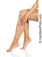 Legs pain concept - legs tied with rope isolated