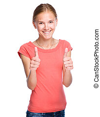Young girl is showing thumb up gesture - Young girl dressed...