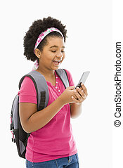 Girl text messaging. - African American girl with backpack...