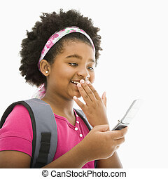 Girl with cell phone. - African American girl with backpack...