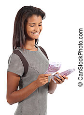 Beautiful african american businesswoman counting money...