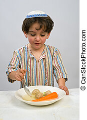 boy matzo ball soup - Jwish young boy having matzo ball soup