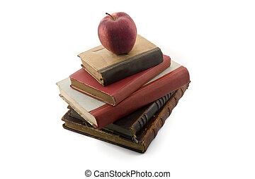 apple on old books