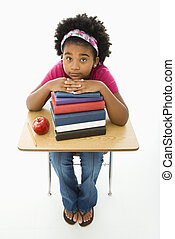 Girl at school desk - African American girl sitting at...