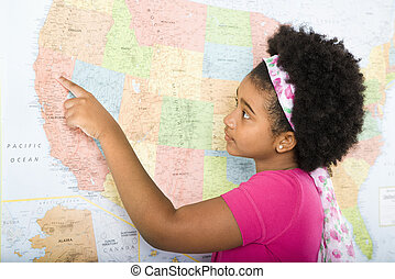 Girl with USA map. - African American girl pointing on map...