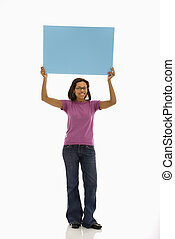 Woman holding sign.