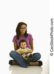 Mother and child. - African American mid adult mom sitting...