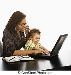 Business mom with baby - African American businesswoman at...