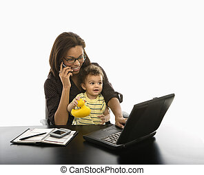 Businesswoman and baby. - African American mid adult...
