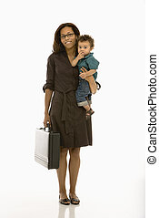 Business mom with child - African American mid adult...