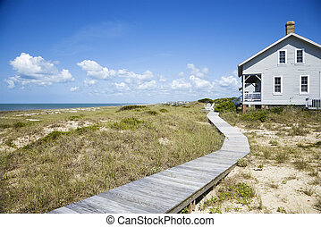 Beachfront house. - Beachfront house with wooden walkway.