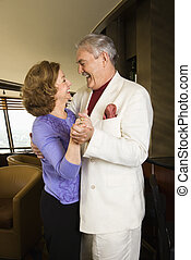 Couple dancing - Mature Caucasian couple dancing and...