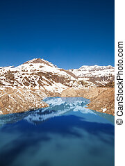 Lake Emosson reservoir of hydroelectric Dam near village of...