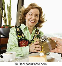 Woman getting present - Mature Caucasian couple having...