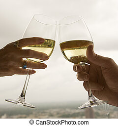 Couple toasting - Close up of mature couples hands toasting...