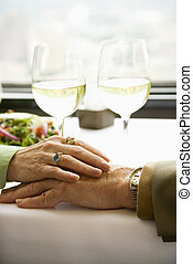 Couple touching hands. - Close up of mature couple at...