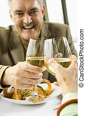 Couple celebrating - Caucasian mature couple toasting with...