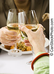 Couple toasting wine. - Caucasian mature couple toasting...