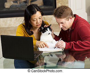 Mature Couple and family pet working from Home - Photo of...
