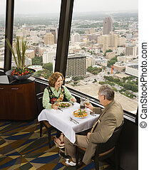 Mature couple dining - Mature couple dining in fancy...