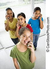 Girls on cell phones. - Preteen girls of mutiple ethnicities...