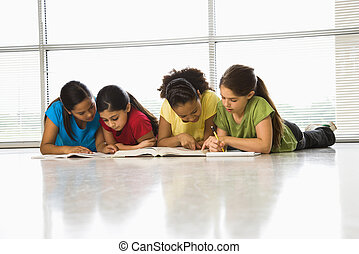 Girls doing schoolwork - Preteen girls of mutiple...