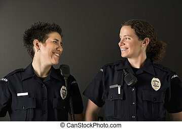 Two Policewomen. - Two mid adult Caucasian policewomen...