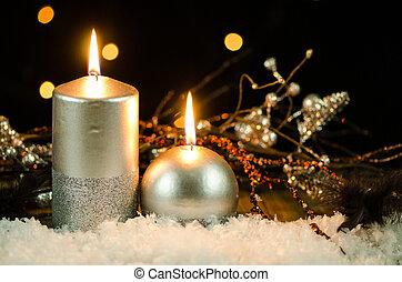 Christmas candles - Silver christmas decoration on snow...