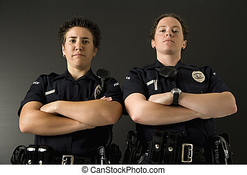Two policewomen. - Portrait of two mid adult Caucasian...