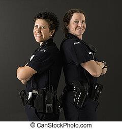 Policewomen back to back.