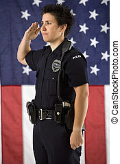 Policewoman saluting - Portrait of mid adult Caucasian...