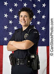 Policewoman and flag. - Portrait of mid adult Caucasian...