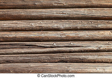 Wooden logs wall of old rural house background