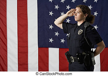 Policewoman saluting. - Side view of mid adult Caucasian...