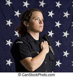 Patriotic policewoman. - Portrait of mid adult Caucasian...