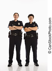 Policewomen crossing arms - Portrait of two mid adult...