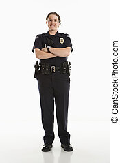 Smiling Policewoman - Portrait of mid adult Caucasian female...