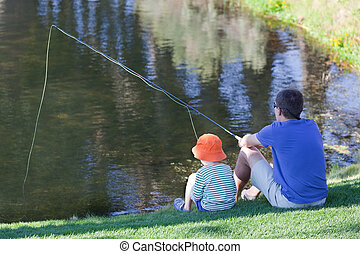 family fishing - father and his son fishing together