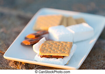 smores, marshmallow, chocolate and graham crackers ready on...