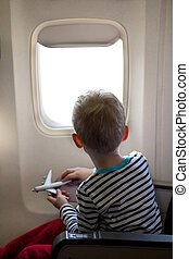 boy in the plane - little boy sitting inside the plane and...