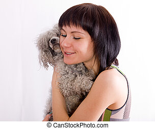 The girl embraces a dog