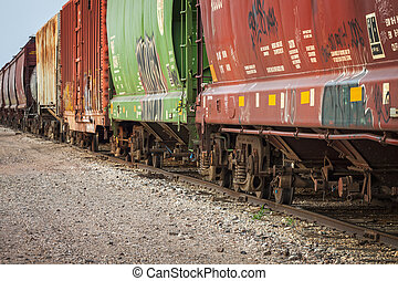 Freight Train Cars on Tracks - Freight train cars on...
