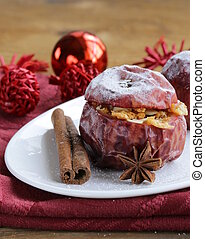 Baked apples with spices anise, cinnamon winter holiday...