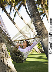 Female in hammock. - Pretty young adult Caucasian brunette...