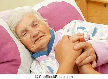 Love in the family - Happy elderly woman holding daughters...
